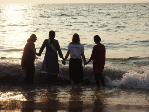 TAKING A DIP IN THE ARABIAN SEA WITH A GROUP OF WOMEN FROM KERALA WHO LET ME JOIN IN ON THEIR FUN