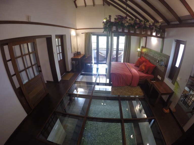 The honeymoon suite at Vythiri Resort, Wayanad with a glass floor and a private pool