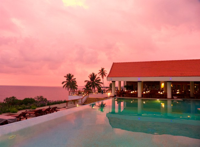 Pink-sunset-by-Leela-Hotel-pool